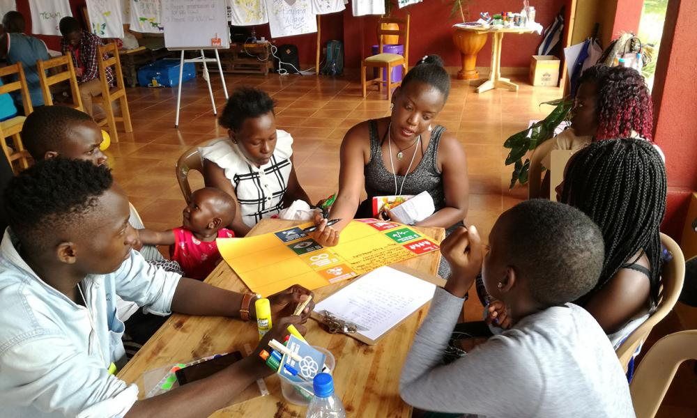 Teen Advisory Group Uganda: Adolescents selecting and discussing the eight Sustainable Development Goals they feel are most important to them as young people (photo by: Inge Wessels)