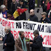 A group of people protesting Front National